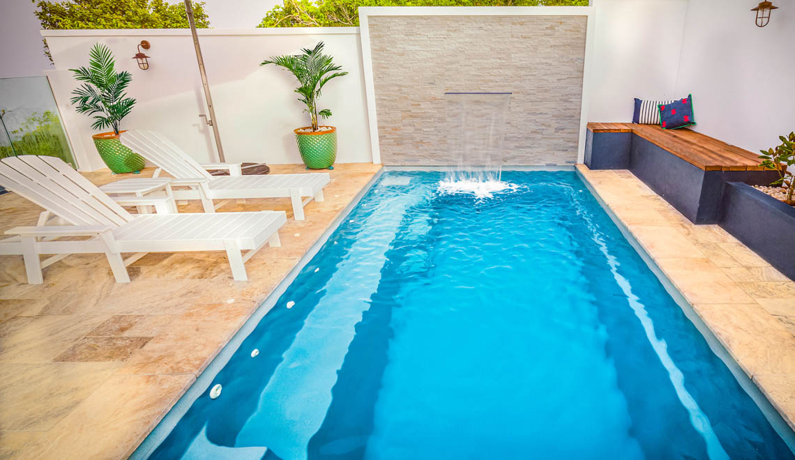 Leisure Pools Harmony composite swimming pool with built-in bench seat
