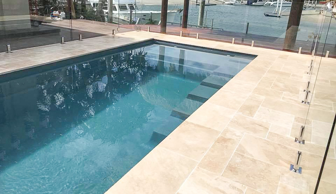 Leisure Pools Precision composite swimming pool with built-in splash deck